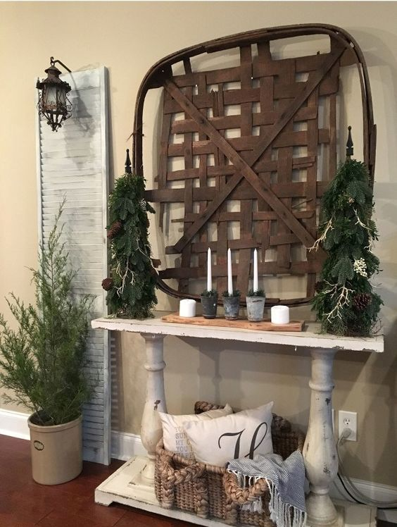 33-a-tobacco-basket-evergreens-candles-and-moss-is-right-what-you-need-for-an-organic-entryway