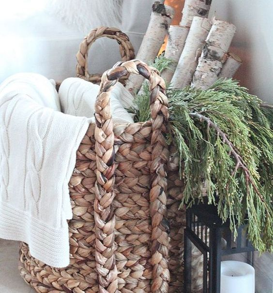 34-birch-logs-greens-and-a-throw-in-a-basket