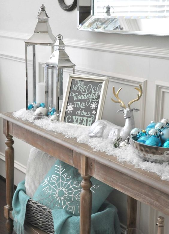 34-cover-your-console-table-with-faux-snow-place-a-couple-of-silver-lanterns-put-some-turquoise-textiles