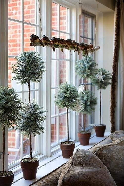 34-pale-potted-greenery-and-faux-birds-on-a-branch-display