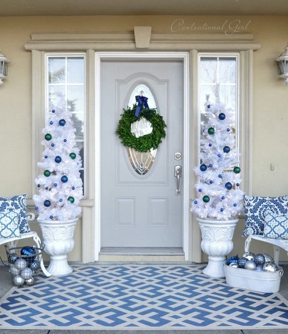 35-navy-blue-and-white-Christmas-porch-decor-with-ornaments-and-white-trees-in-urns