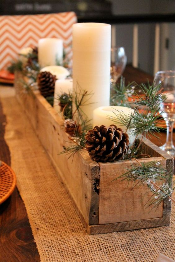 35-rustic-wooden-box-centerpiece-with-candles-pinecones-and-evergreens