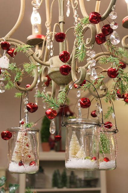 38-bottle-brush-trees-in-hanging-glass-votives-fir-branches-and-red-jingle-bells