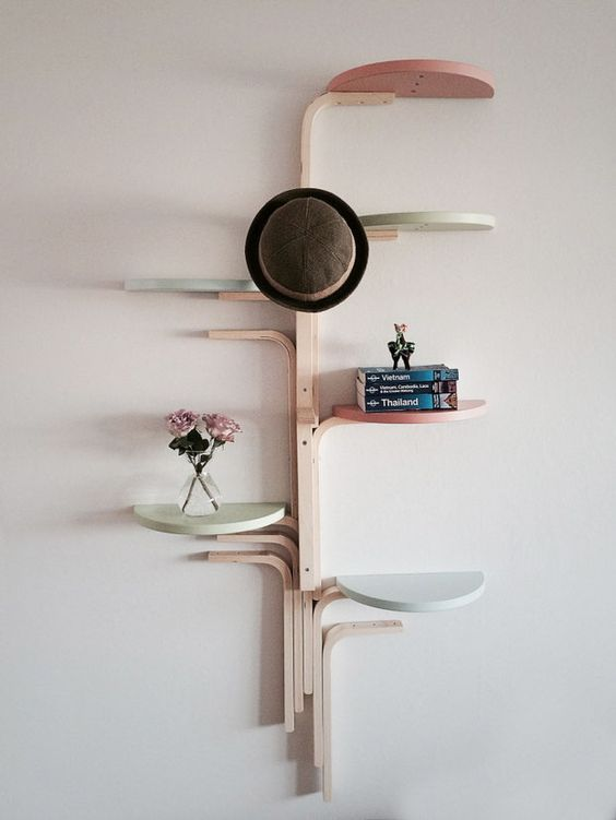 41-wall-mounted-shelf-made-of-several-stools-and-painted-in-pastel-colors