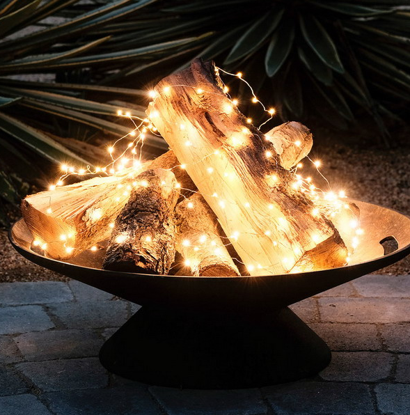 02-a-metal-bowl-with-firewood-and-string-lights-to-imitate-a-fire