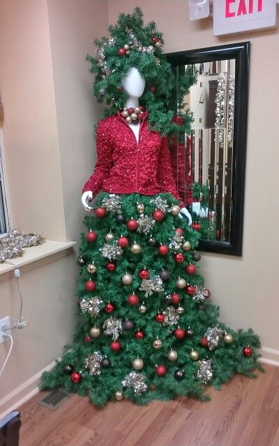 02-manequin-Christmas-tree-with-a-red-jacket-and-a-tree-skirt