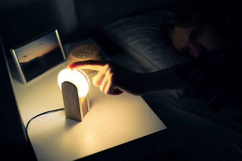 03-Theres-a-small-wooden-stand-for-Clipse-which-allows-to-place-it-there-and-use-as-a-nightstand-or-just-a-side-light-775x517