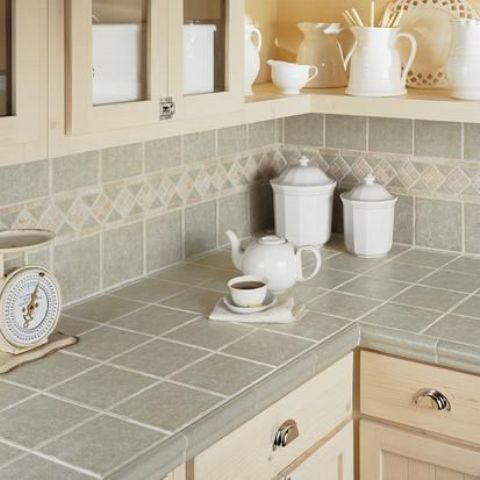 03-grey-tiles-on-the-backsplash-and-countertops-with-beige-grout