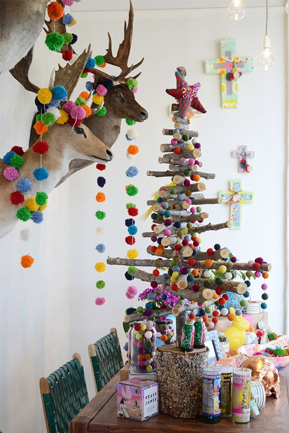 06-stick-Christmas-tree-and-taxidermy-decorated-with-colorful-pompoms