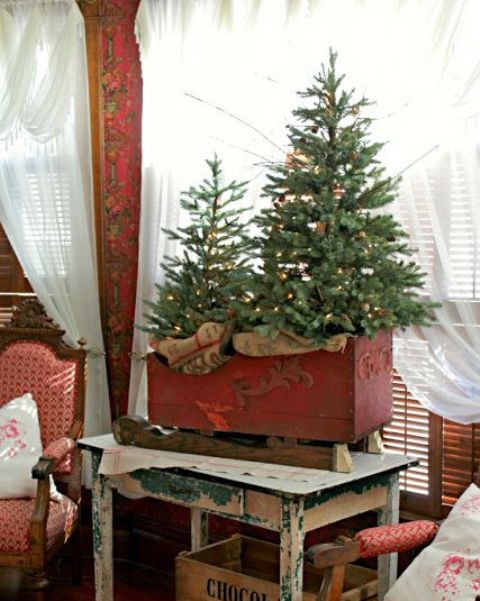 13-vintage-red-sleigh-with-a-Christmas-tree-duo-with-lights