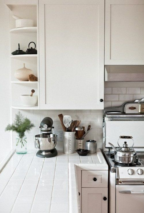 13-white-tiles-on-the-countertops-and-backsplash-white-grout