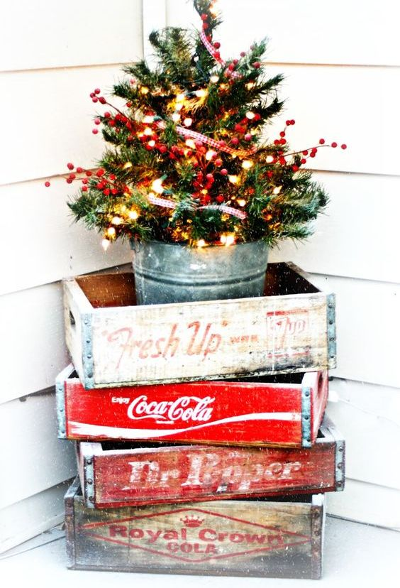 14-a-small-tree-with-lights-and-berries-in-a-glavanized-bucket-and-crates