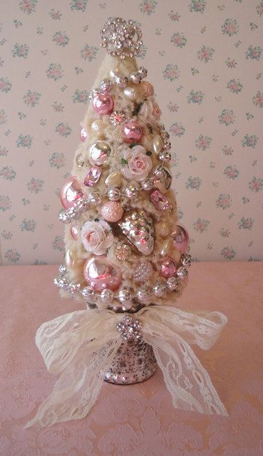14-tabletop-glossy-ornament-Christmas-tree-with-jewelry-and-a-lace-bow