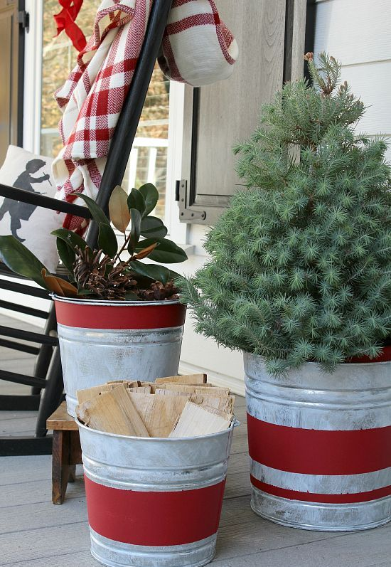 17-aged-red-stripe-galvanized-buckets-with-wood-greenery-and-an-evergreen-tree