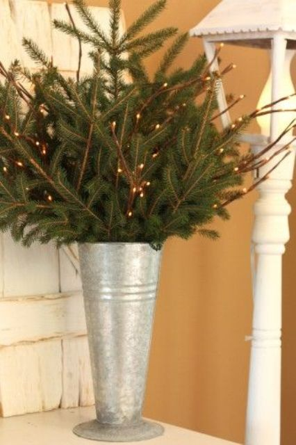 20-galvanized-bucket-with-evergreen-and-light-branches