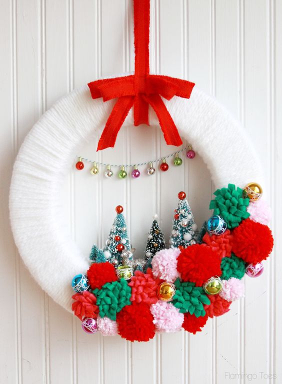 21-winter-wonderland-Christmas-wreath-with-pompoms-and-bottle-brush-trees