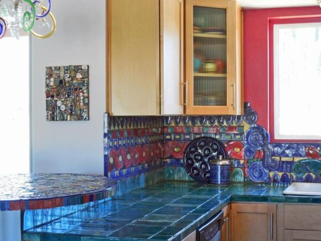 24-very-bold-teal-tiles-on-the-countertops-and-red-and-blue-tiles-on-the-backsplash