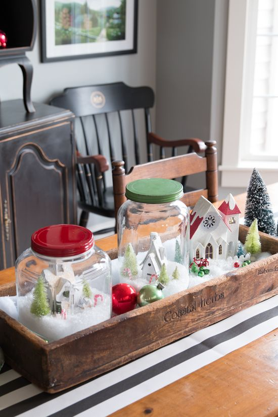 25-a-wooden-crate-with-jar-snow-globes-and-ornaments-as-a-centerpiece