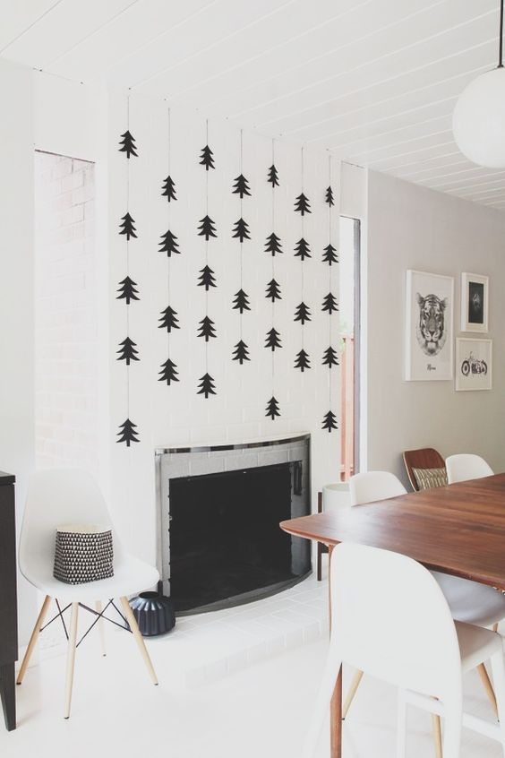 33-statement-fireplace-wall-with-black-trees-over-it