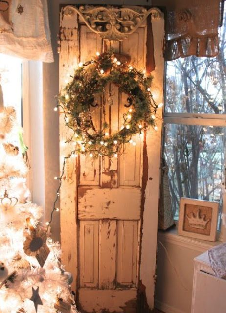 35-shabby-chic-door-inside-the-house-with-a-lit-up-wreath-of-greenery