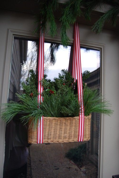 36-a-basket-with-evergreens-and-striped-ribbon