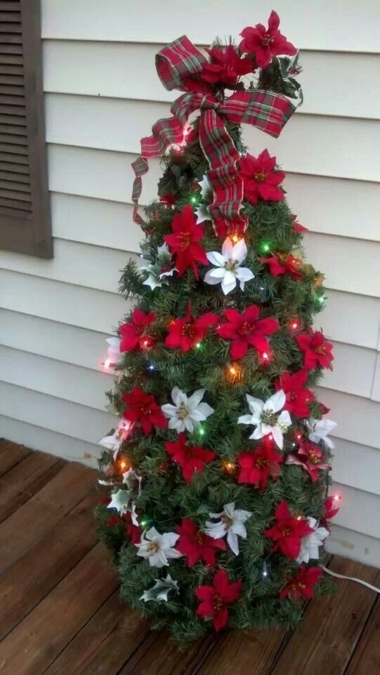 36-small-tomato-cage-Christmas-tree-with-red-and-white-poinsettia-flowers