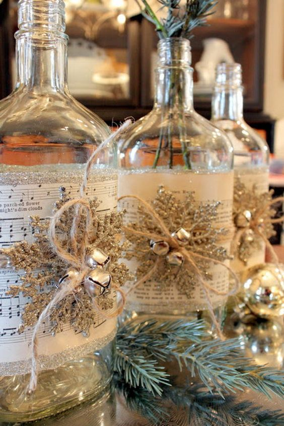 41-such-bottles-covered-with-music-sheets-snowflakes-and-jingle-bells-can-be-DIYed-and-turned-into-vases