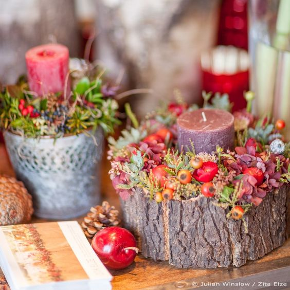 44-wooden-log-with-a-candle-flowers-and-berries