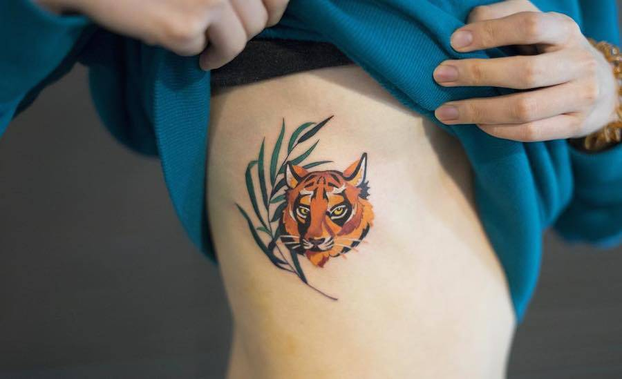 Delicate-and-Cute-Ornamental-Tattoos-2-900x549